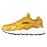 Золотые женские кроссовки Nike Air Huarache WmNs Gold